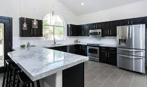Black Kitchen Cabinets With White Marble Countertops Backsplash