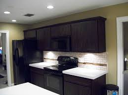 Expresso Kitchen Cabinets Mesmerizing Espresso Kitchen Cabinets With White Quartz Countertop