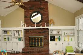 painting a fireplace whiteRemodelaholic  Dramatic Results Of a White Painted Brick Fireplace