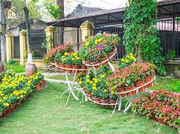 Appealing Design Of The Backyard Areas With Colorful Flower As The Bed  Flower Design Ideas Added