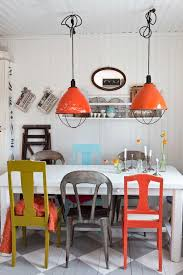 unusual dining room furniture. Mismatched Chairs Are So Fun! Dining Room Or Restaurant Décor Idea Using Found Pieces: Orange Industrial/barn Lights, [painted Orange, Ochre, Grey Chairs, Unusual Furniture U