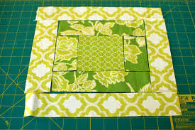 12 Days of Handmade Christmas Day 4|Quilted Potholder - life{in}grace & Start sewing from the center out. Use a 1/4″ seam allowance when sewing. .  Here are the first two pieces sew together: Adamdwight.com