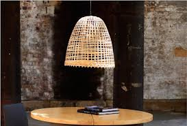 take this bamboo basket lamp for example this simple utilitarian item has found new life albeit upside down as an attractive pendant lamp