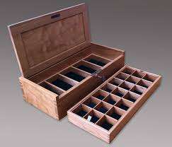 a small jewelry box with a lock the sides and top are a bit thicker