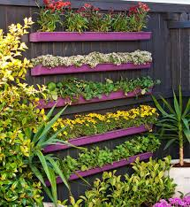 how to make a vertical garden. diy projects - how to build a gutter vertical garden planter via bhg make