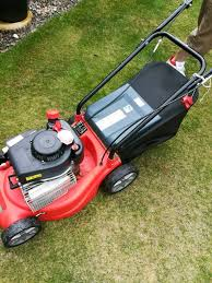 sovereign petrol lawn mower 70 and petrol industrial strimmer 50 livingston