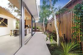 view in gallery sliding glass doors connect the interior with the rear hangout