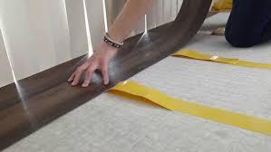 laying vinyl tile vinyl plank flooring how to lay self adhesive vinyl planks diy doctor