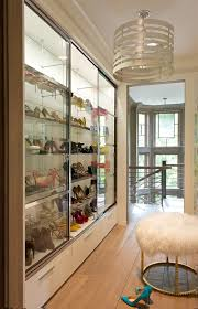 the room has smart storage with ample drawers and rods and she added the all important ottoman for seating she also copied a few tricks from boutiques
