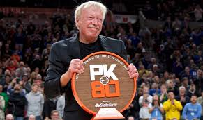 nike co founder phil knight is presented with a plaque during the first half of