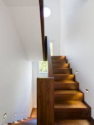 staircase lighting design. Example Of A Mid-sized Trendy Wooden U-shaped Staircase Design In London Lighting S