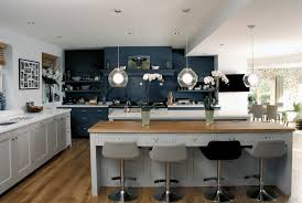 a large traditional kitchen with two islands