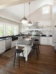 Elegant Example Of A Transitional U Shaped Kitchen Design In Portland Maine With A  Farmhouse Sink Photo