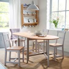 a traditional dining room with gamleby gate table and chairs in pine wood and grey