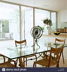 Modern Kitchen Dining Area White Units Glass Table Wood Chairs