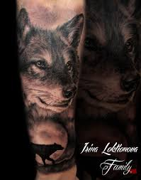 на предплечье тату волка татуировка волка стилизованная на