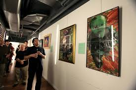 as doorman 10 years ago shows a piece left featuring his son and another right featuring his nephew credit hiroko masuike the new york times