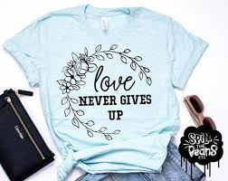 Plus In Love Size Chart Love Never Gives Up Positivity Tee Womens Fashion Womens Tee Plus Size Graphic Tee Gift For Her Motherhood Shirt Encouragement