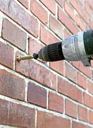 where to drill brick vs