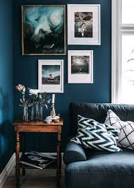 blue living room ideas. Living Room With Dark Blue Marine Walls, Layered Art, And A Vintage Table Ideas