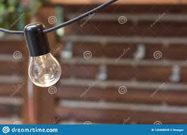 How To Hang Rope Lights On Brick One Old Bulb Hanging From The Ceiling Close Up On Background