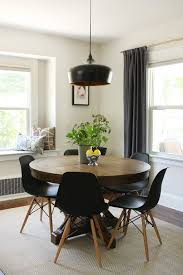 mid century modern round dining tables. thinking about a round table for that space. world market and chairs in mid century dining room modern round tables