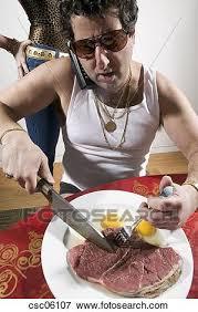 eating raw steak. Perfect Raw Man Eating Raw Steak And Eggs To Eating Raw Steak