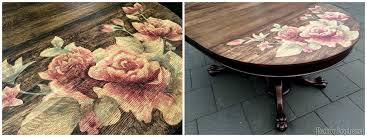 stained rose artwork on clawfoot table