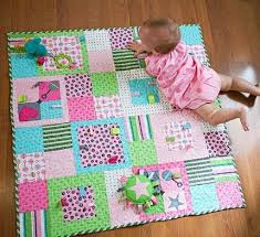 Best 25+ Quilts using fat quarters ideas on Pinterest | Baby quilt ... & Add fun and fuction to a stroller-size quilt by sewing ribbon and rickrack  loops into the blocks. Adamdwight.com