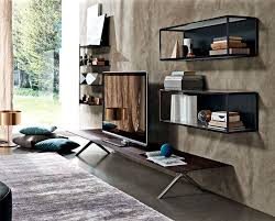 the coffee tables also offer a world of entertainment and original versatility the clyde double topped low table harmoniously brings together no less than