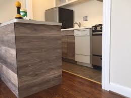 how to reface kitchen cabinets using vinyl flooring curbly