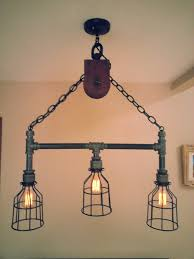 industrial pipe lighting. Hanging Industrial Pipe Pulley Light With 3 By DesertandIron Lighting R