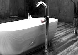with proper planning the spout will be positioned near the drain and out of your way when you are in the tub