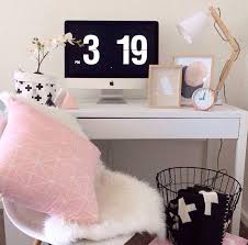 pink white and black desk area