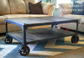 grey rectangle pallet wood diy industrial coffee table designs with metal wheels for living room decorating