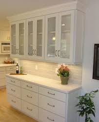 shallow buffet built of white shaker cabinets with textured glass ...