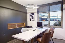 Small office architecture Architectural Dige View In Gallery Gray Accent Wall And White Backdrop Highlight The Sea View Outside The Window Homedsgn Small Architectural Office With View Of The Ionian Sea