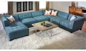 m u shape blue suede tufted sectional sofa with right chaise lounge using black acrylic legs placed elegant tufted sectional sofa