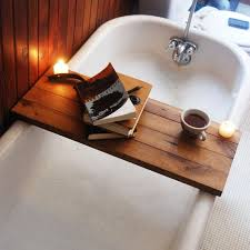 Our Tub Caddy is a bathtub tray made from eco-friendly wood. Enjoy a book  as you relax in a hot bath, and use it as a bathroom shelf when you're done.
