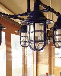 finding a high quality light fixture that could handle not only the constant traffic of a commercial space but also the weather fluctuations of the patios
