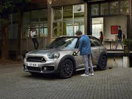 the new mini countryman plug in hybrid combines everyday use and readiness to go long distance in one electrifying package drive locally co2 neutral when