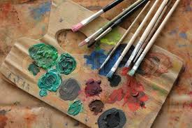 paint brushes and paint. paint brushes and color on the palette background | stock photo colourbox