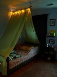 DIY Tent over the bed--this is cool. Like the light, gotta do this ...