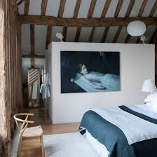 bedroom design uk. attic bedroom with exposed beams and blue white bed design uk