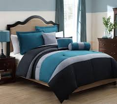 teal and light and dark grey bedding on white linen