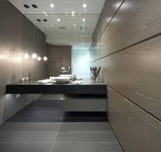 large wall tiles basement bathroom