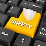 Photo of a keyboard with the Word safety on return key