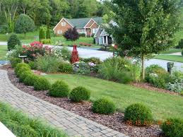 Front yard landscape design. Good balance of elements here and an overall  nice feeling with