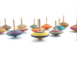 2 wooden spinning tops