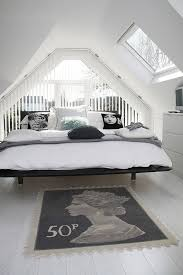 dashing attic bedroom in black and white design model projects